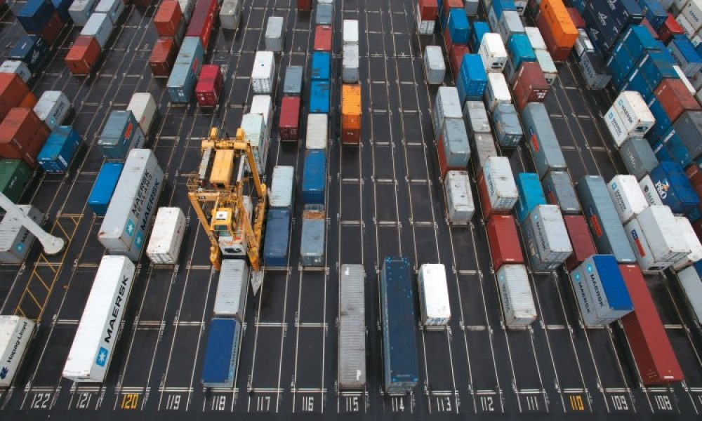 ACA World A straddle carrier moving through the container stacks